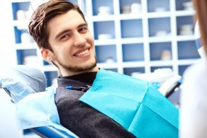 man smiling in the dental chair